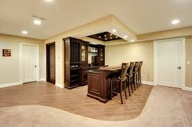 basement with a custom wooden millwork bar and two paint grade mdf