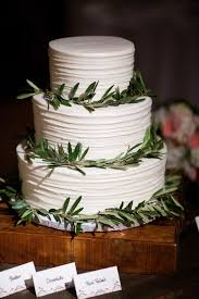 wedding cake greenery simple three tier wedding cake with greenery rings