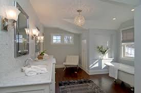 bathroom cabinets mini crystal chandelier over white oval for