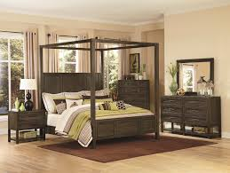 King Size Canopy Bed Frame Carved Wrought Iron Four Poster Canopy Bed And On Brown Hardwood