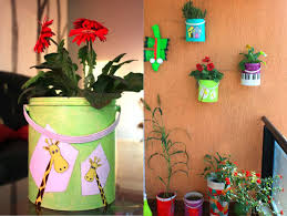 upcycling paint containers into colorful wall hung balcony