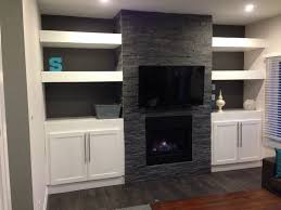 built in cabinets next to fireplace living room farmhouse with