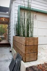 blumenkasten holz balkon sichtschutz mit pflanzkübel blumenkasten holz natur geölt