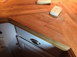 stick a fork in them the ikea butcher block counters are done and i think the icing on the cake is that this joint actually made a far stronger joint than if it were just a flush cut the two back pieces of counter