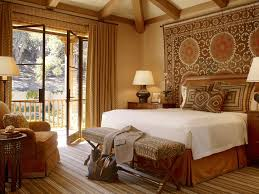 earth tone bedroom bedroom traditional with foot of the bed