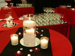 black and gold themed centerpieces and table decorations