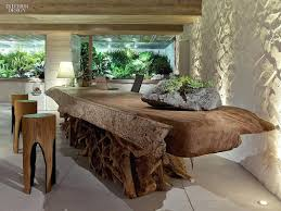 desk modern design a desk and thatched umbrella sit inconguously