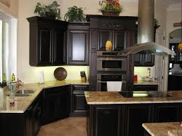 black color painted oak kitchen cabinet for small kitchen spaces black color painted oak kitchen cabinet for small kitchen spaces with brown granite countertop and white wall interior decor ideas