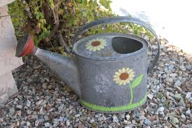 stenciled watering can with new martha stewart decorative paint line