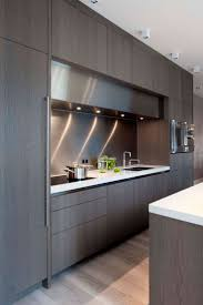 cabinets storages contemporary kitchen cabinets for a posh and amazing grey contemporary sleek finish wooden kitchen cabinet led under counter lighting white granite countertop stainless