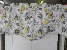 white curtain with yellow flowers and gray leaves pattern as well
