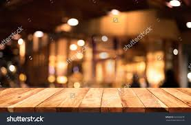 Dark Wooden Table Top Wood Table Top On Blurred Of Cafe Restaurant With Light Gold