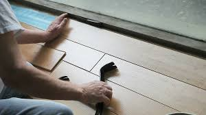 Diy Laminate Flooring Man Puts In Laminate Flooring Diy Stock Video Footage Videoblocks