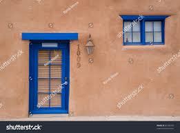 adobe house blue door window stock photo 89150359 shutterstock