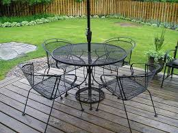 cast iron outdoor table not the ideal patio set but it s a set nonetheless if we get a