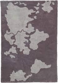 world map cotton rug in dark grey by lorena canals