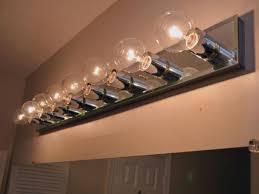 installing bathroom light fixture over mirror mirror ideas