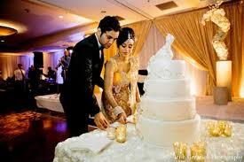 wedding cake cutting indian wedding reception cake cutting groom and