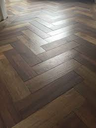 Black Laminate Flooring Tile Effect Dark Wood Effect Porcelain Floor Tiles Laid In A Herringbone