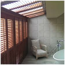 plantation shutters for an unusual window a wimbledon home project