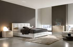 wood and upholstered bed bedroom transitional with bay area