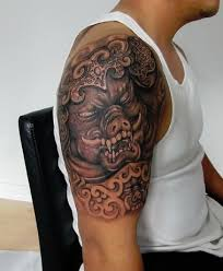 traditional chinese boar head tattoo on half sleeve