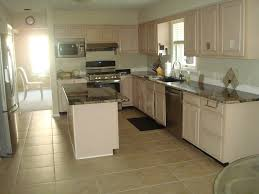 Kitchen With Cream Cabinets by Help Should I Paint My Cabinets Black Or Cream Or Taupe