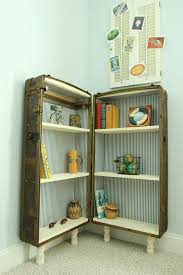 How To Make A Dollhouse Out Of A Bookcase Repurposed Suitcase Suitcase Crafts
