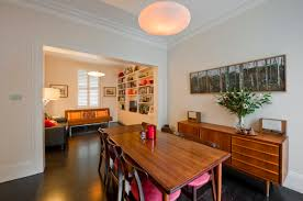 dining room dark hardwood floor with dining table and shabby chic