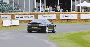 aston martin rapide shows its aston martin zings up goodwood hill to its amg future in vantage