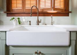 how to install farmhouse sink in base cabinet installing an apron front sink how tos diy