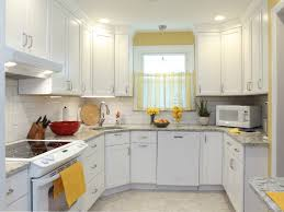 full height white cabinets with matching crown molding quartz