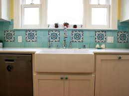 blue chevron ceramic tile backsplash installed in the kitchen with