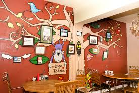 a cafe that s more than just food 3bl media this trees of thanks mural on a wall