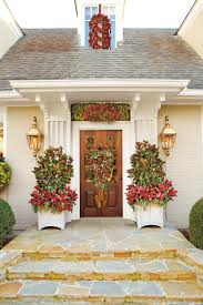 pictures of christmas decorations in homes 21 festive front porches from across the south southern living