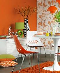 awesome dining room with orange wall paint white orange chairs