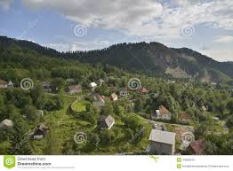 Landscape With Houses by Landscape With Houses At Rosia Montana Romania Europe Stock