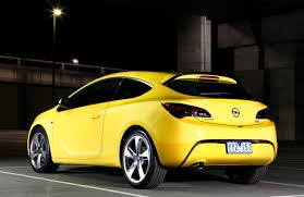 opel yellow opel astra gtc pricing and specifications revealed photos 1 of 6