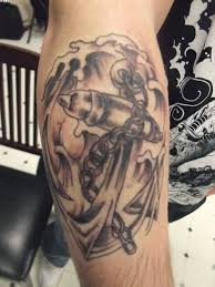 grey ink waves and chain anchor tattoos on arm tattooshunter com