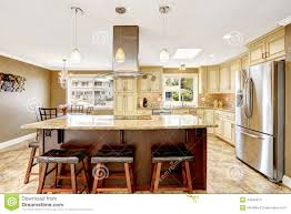 beautiful kitchen island with granite top and hood stock photo