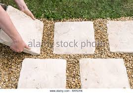 Laying Patio Slabs On Grass Laying Paving Slabs Stock Photos U0026 Laying Paving Slabs Stock