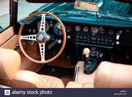 jaguar e type classic car cockpit with wooden steering wheel