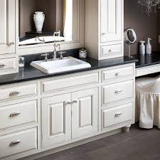 shaker style bath with white cabinetry black vanity countertops