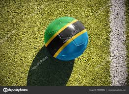 Flag Of Tanzania Football Ball With The National Flag Of Tanzania Lies On The Field