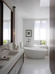 bright bathroom interior with clean white wall paint and completed