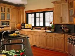 kitchen with black countertops and pine cabinets durable pine
