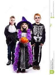 one little and two boys dressed the halloween costumes witch