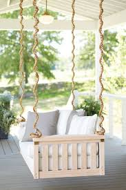 10 ways to make a big outdoor statement how to decorate sunday porch swing from ballard designs