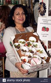 where to buy chocolate dipped strawberries a festival vendor displays chocolate covered strawberries for