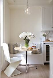 dining room small white breakfast nook with round extendable
